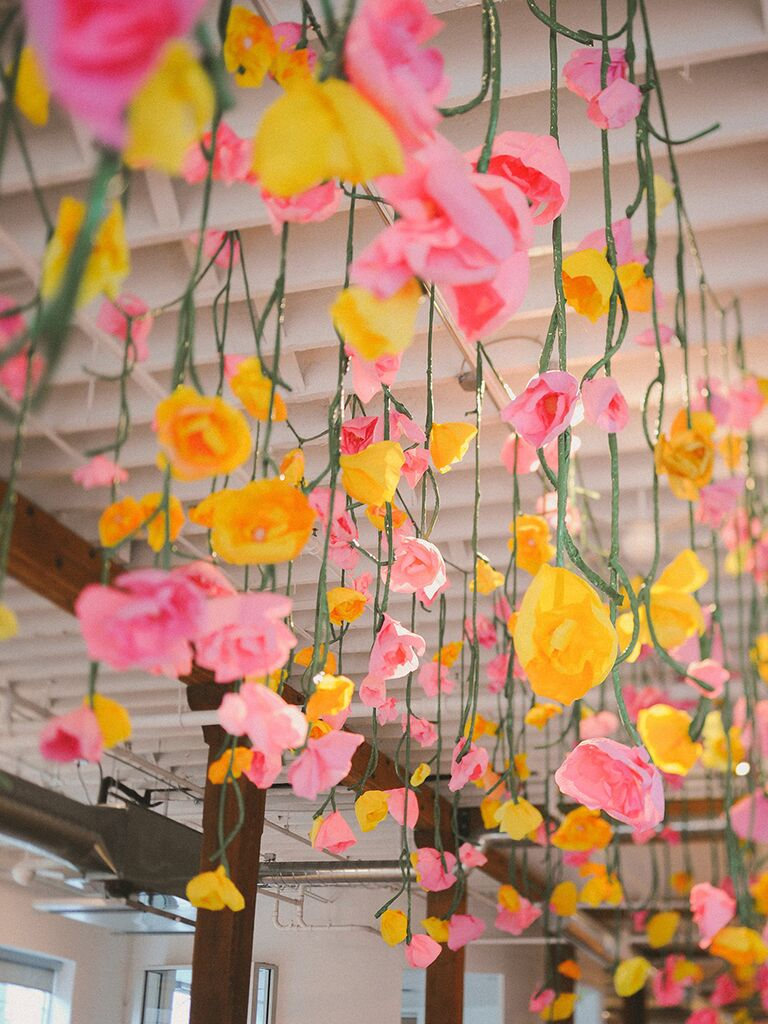 15 ways to use paper flowers at your wedding pink and yellow paper flower decorations mightylinksfo