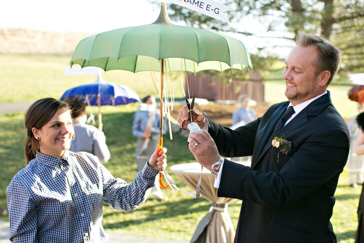 Even their escort card display was over the top! All guests (including David) found their escort cards hanging from actual vintage parasols held by the venue's staff. Each umbrella had a sign with the name range of cards under its fabric.