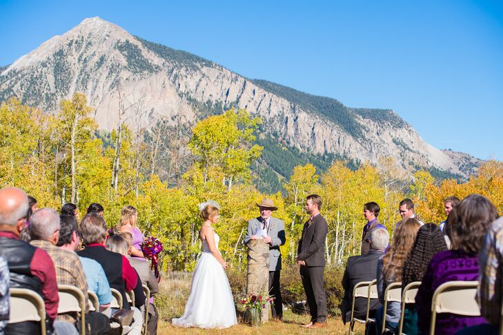"""We chose to host our wedding outdoors in a grassy meadow called the Woods Walk just above the town of Crested Butte, Colorado,"" Dawn says. ""We chose this location because of the beautiful views [looking out to Mount Crested Butte]; it's set in an aspen grove, which was golden yellow during our wedding; and was within walking and biking distance of the reception venue and many of our guests' lodging."""