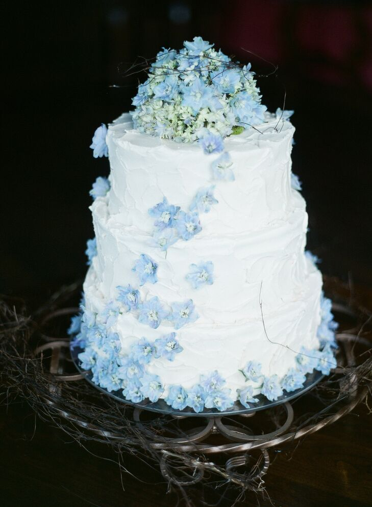 The simple, three-tier cake was iced with vanilla buttercream and topped with fresh flowers.