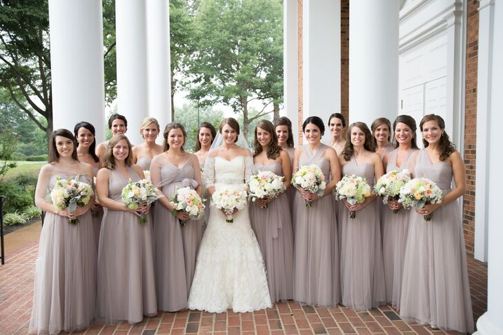 """The goal for the bridesmaids' look was to pick a color that wouldn't stick out in pictures 40 years later!"""" says Hailey. """"We chose a long, chiffon dress in mink grey by Jenny Yoo. The bridesmaids had countless options for how to style to top half of the dress."""""""