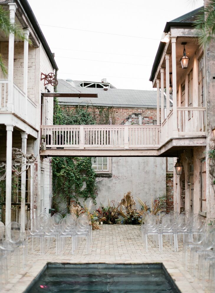 Vintage Ceremony Site with Modern Ghost Chairs at Race & Religious in New Orleans, Louisiana