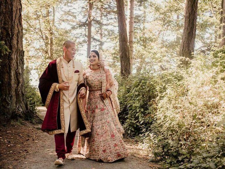 Bride wearing gold bridal lehenga with red embellishemnts