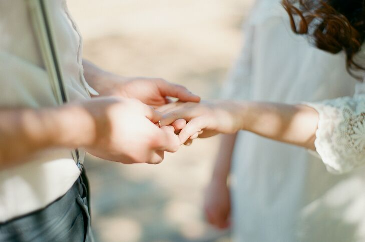 During the simple ceremony, the couple placed the wedding rings on each other's finger.
