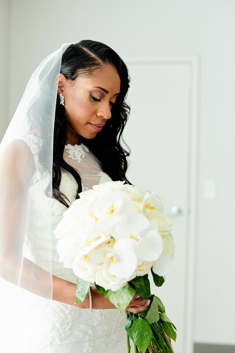 Bride holding elegant white wedding bouquet