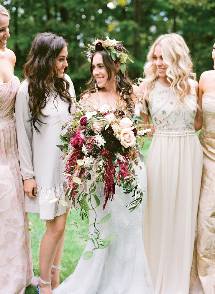 "Clusters of roses, dahlias, stephanotis and hanging amaranthus created an overflowing burgundy bridal arrangement. ""I wanted my flowers to be wild-looking and romantic instead of a round, perfect bouquet,"" Lauren says. ""It turned out gorgeous—but it was heavy!"""
