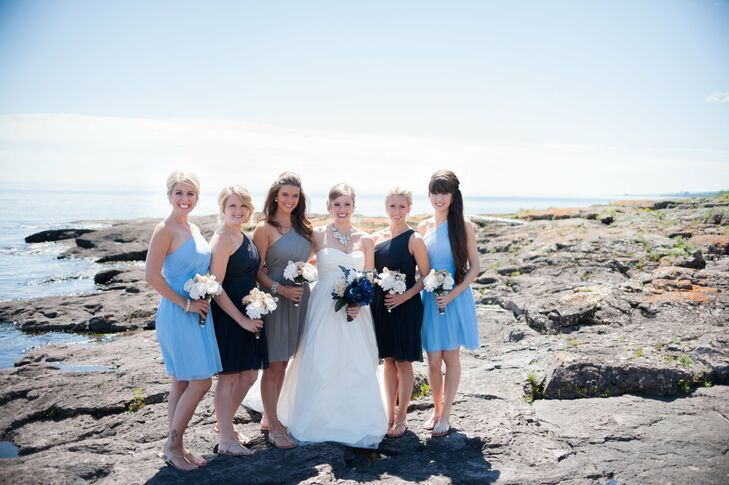 Taylor's bridesmaids alternated in dark and light blue shades of the same J.Crew dress while her maid of honor popped in gray.