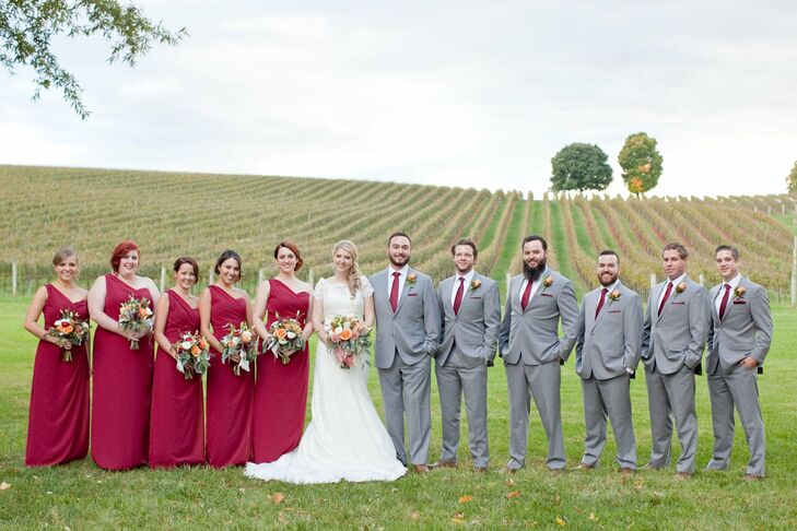 Andrea's bridesmaids wore floor-length red dresses with elegant one-shoulder necklines. The groomsmen matched Kyle in gray suits and burgundy ties.