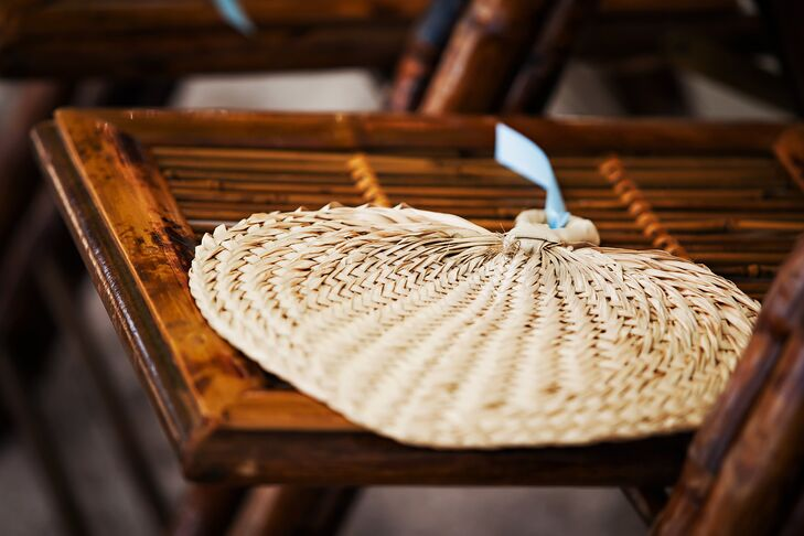 Palm fans were given to guests to combat the heat during the ceremony.