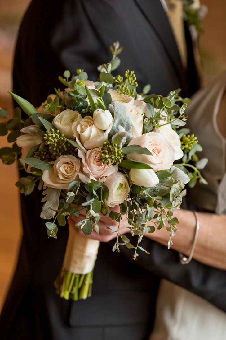 Katherine's bouquet consisted of soft pink roses mixed with eucalyptus. Bill's boutonniere included the same florals.