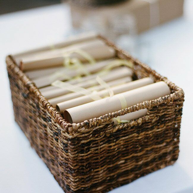 Details about the ceremony were printed on rolled scrolls tied with ribbon.