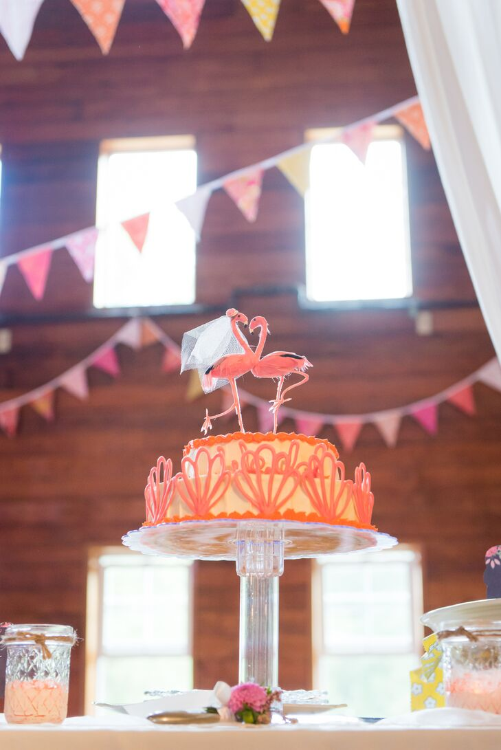 The couple chose to have cheesecake instead of traditional wedding cake, made even more special by the fact that Ben's mother made it. It was a yellow confection decorated with a pink geometric pattern and topped with a pair of flamingos -- the perfect, bright animal to go with their bright color palette.