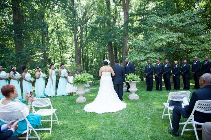 Sicilia and Samuel stood at the front of the space during their ceremony, which took place on the lawn at Liriodendron Mansion in Baltimore, Maryland. They stood in the middle of four stone vases filled with leafy greens.