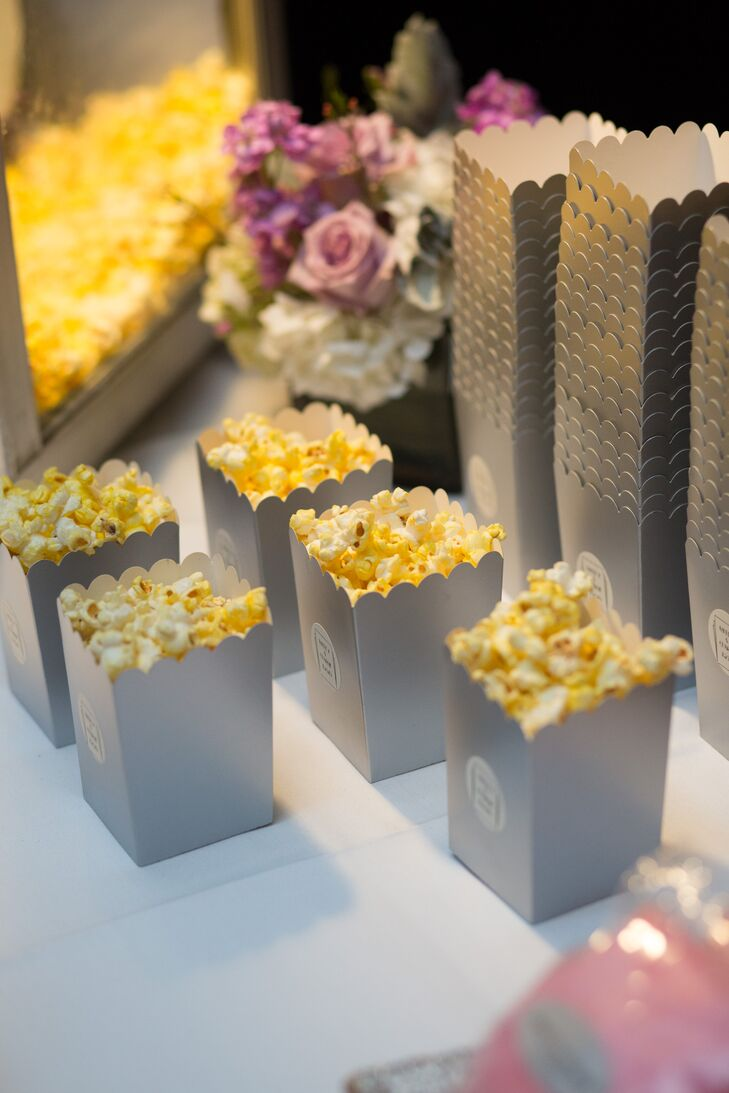 To keep the party going and the dance floor packed, Ashley and Charlie served a late-night snack during the reception at the Roundhouse in Beacon, New York. Guests fueled up on freshly popped popcorn and sweets before heading back to the dance floor to bop to the beat.