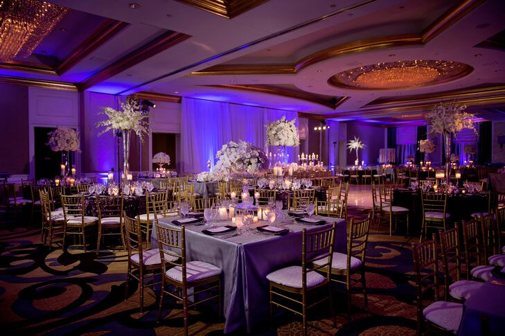 """Angela's decorative inspiration for the ballroom reception was """"modern romance"""" with lavish flower arrangements, mirrored tabletops, custom linens, abundant candlelight and luxe tabletop decor."""