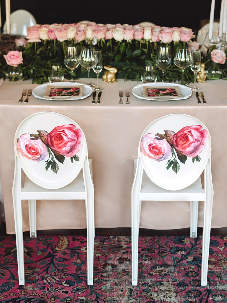 Rose-themed reception decor and fun chairs
