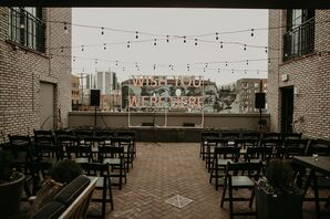 Rooftop Ceremony with Lighted Sign and String Lights
