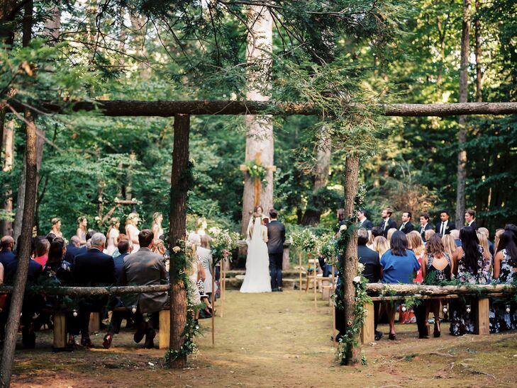 "Before heading to Bedford Golf and Tennis Club in Bedford, New York, for dinner and dancing, Isabella and Bryan exchanged vows in an intimate outdoor ceremony at St. Matthew's Episcopal Church. The venue's woodland chapel provided a whimsical, natural backdrop for the ""I dos,"" with its wooden archway and acres of lush, dense forest. Hedgerow Florist heightened the space's romantic vibe with garlands of wispy vines and ivory blooms."