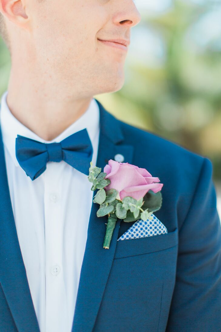 Kenneth added a pop of color to his lapel with a bright purple rose boutonniere garnished with sprigs of fresh, fragrant eucalyptus.