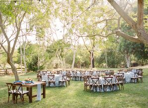 Outdoor Reception with Dark Chiavari Chairs and Blue Patterned Tableclothes
