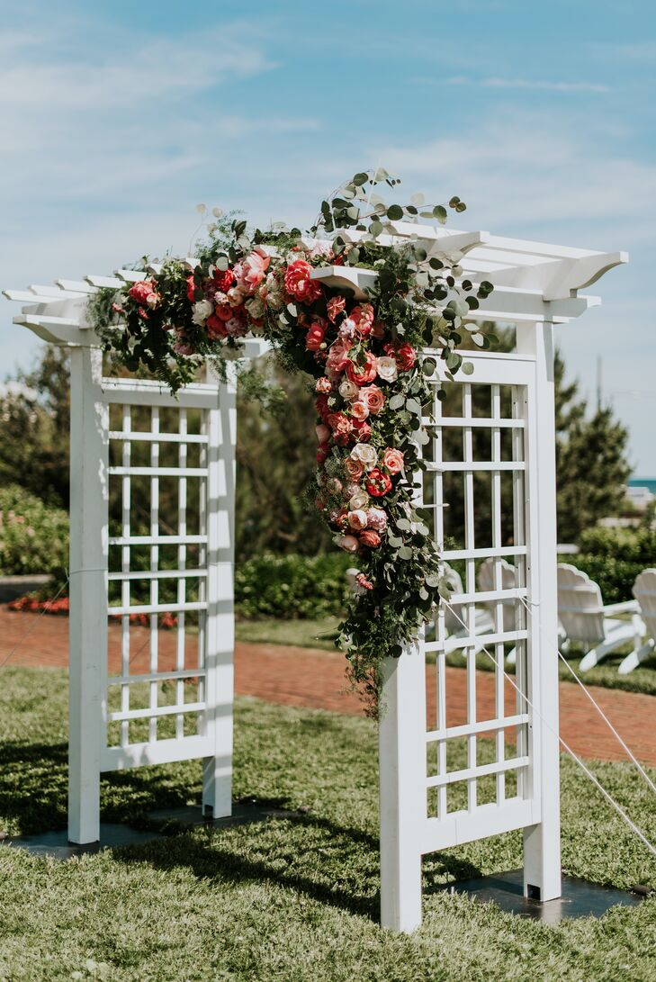 White Wedding Arbor with Eucalyptus and Peonies