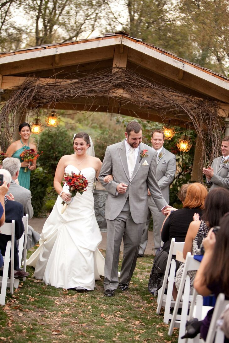 Carly wore an ivory taffeta A-line gown with pickups on the skirt and a sweetheart neckline. Joe chose a classic gray tuxedo and a white tie.