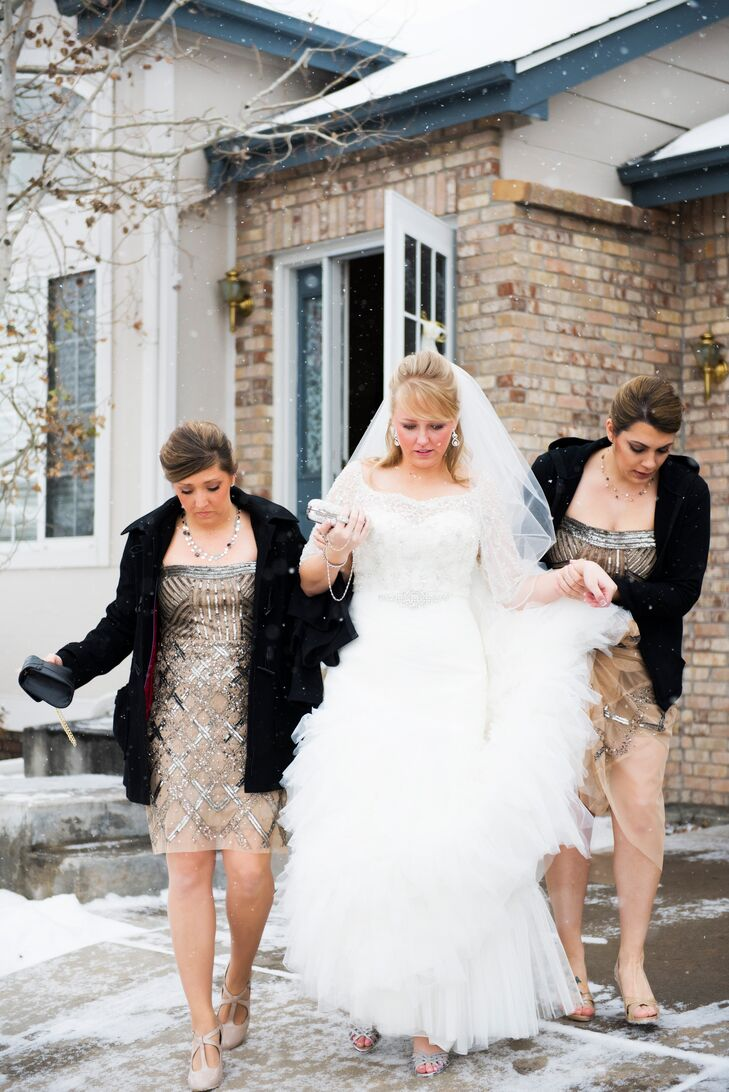 Jessica wore a mermaid wedding dress with a lace and tulle skirt. She wore a crystal shrug over the dress, which shimmered in the glow of the lightly falling snow. Her fingertip-length veil polished off her traditional look for the couple's Catholic ceremony.