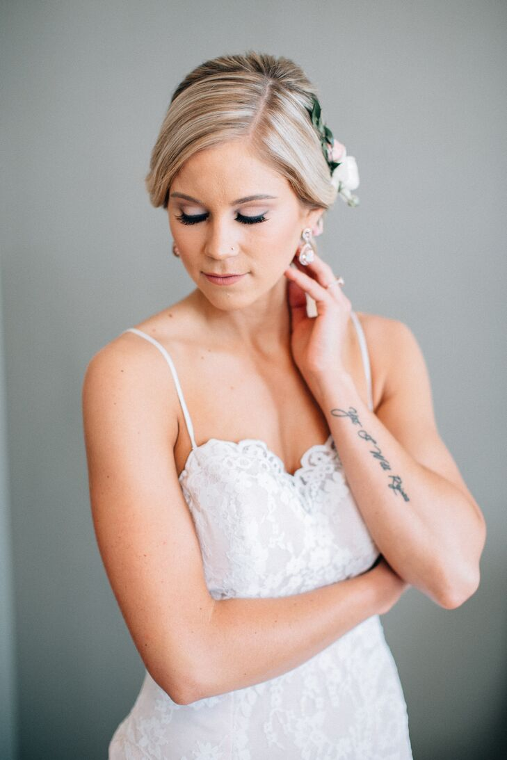 """Ashley wore a fitted A-line gown with delicate straps and a tea rose blush underlay and ivory lace overlay. Makeup was """"natural with a touch of glam,"""" amped up for the special occasion."""