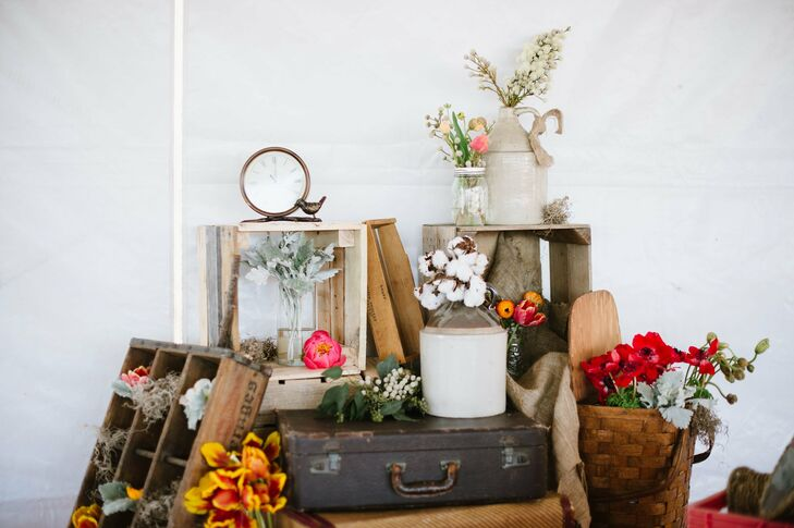 A variety of vintage objects like crates, baskets, crocks and suitcases were decorated with fresh flowers in the day's palette.