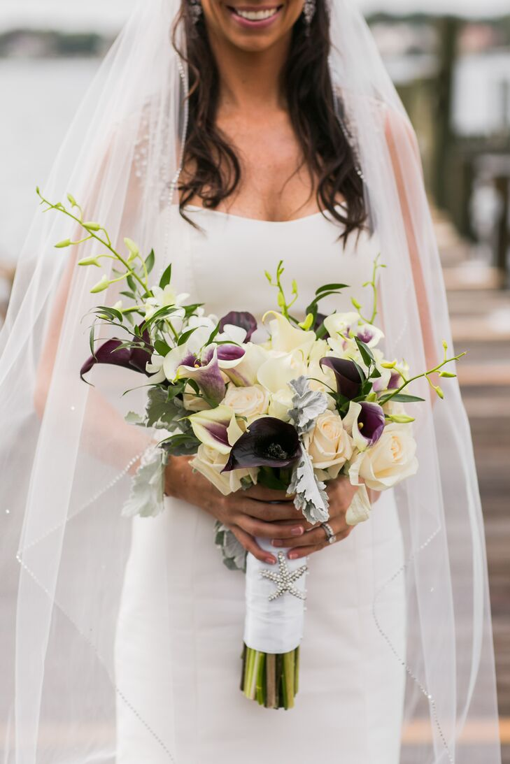 Caitlin carried a modern bouquet of white and purple calla lilies accented with dusty miller.