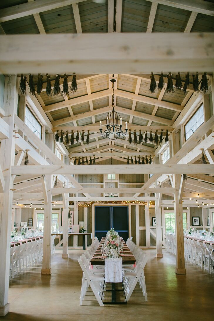 The couple personalized their barn reception space with framed black and white photos of their family members on their wedding days.