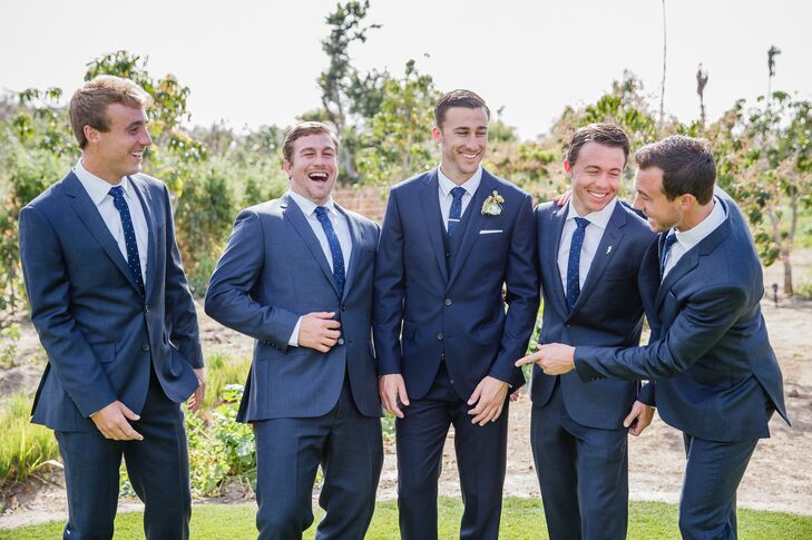 """The groomsmen wore handsome navy suits from J.Crew with simple, navy, polka-dot ties from the Tie Bar,"" Katie says."