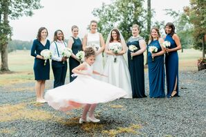 Bridesmaids Dressed in Blue and Whimsical Flower Girl