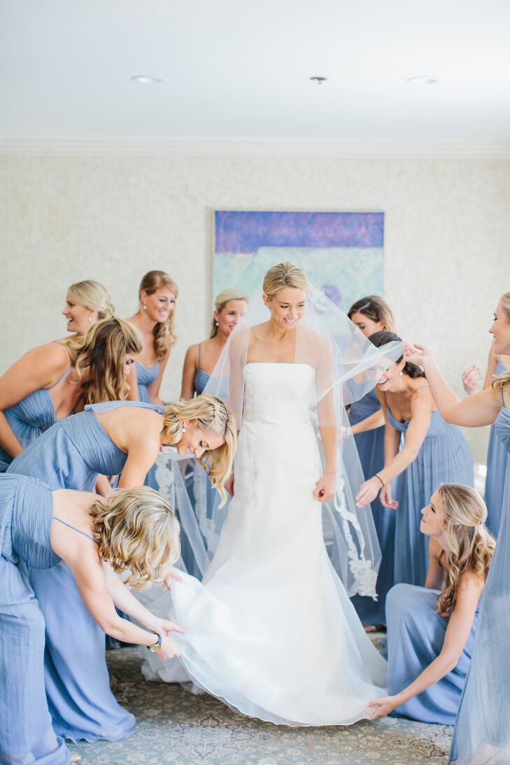 "Collen's 13 bridesmaids wore mixed slate blue Amsale crinkle chiffon long dresses. ""When I went to the Amsale store to try on different dresses, I was in between a few colors, but as soon as I tried on the slate I knew it was perfect!"" says Colleen."
