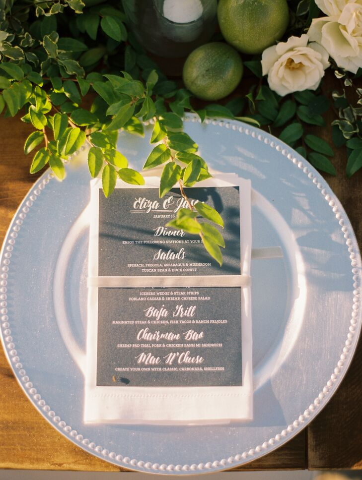 """Whisper"" blue plates were accompanied by white linens and gray menus by Courtney Scowby of Brightly Designed, who helped create the invitation suite."