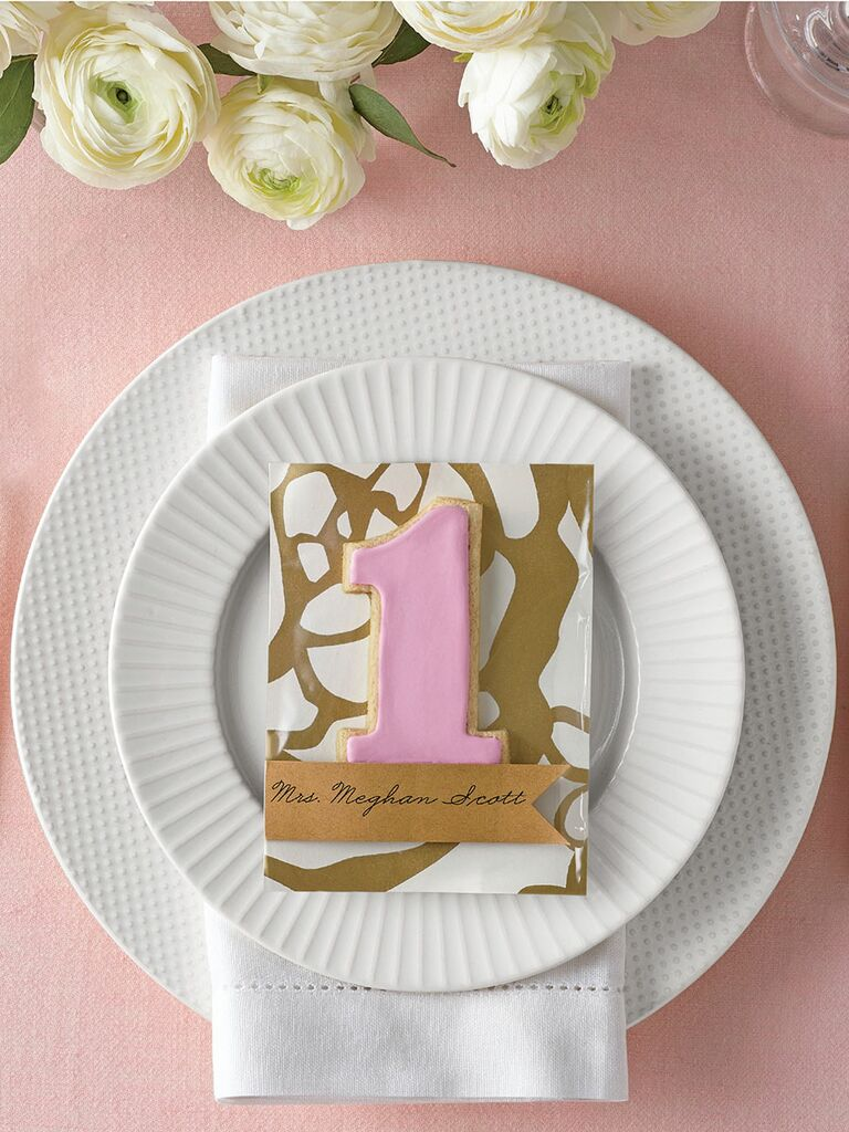 Fun table-number shaped sugar cookie escort card