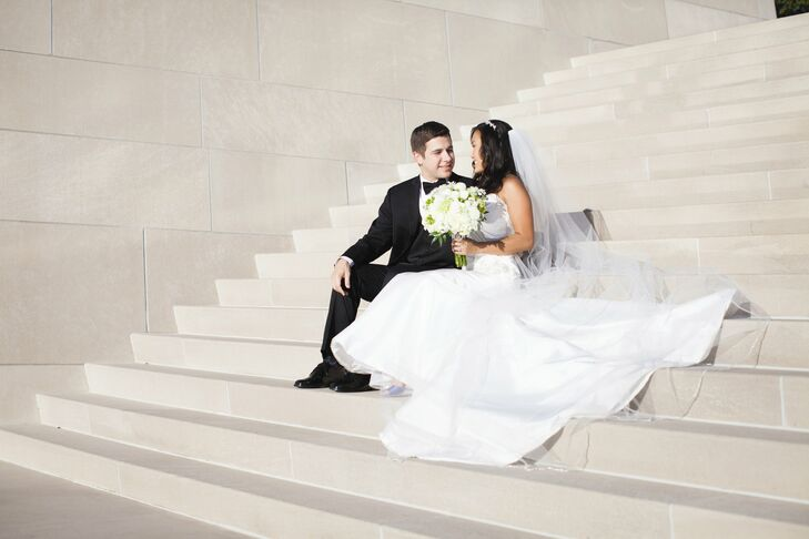The bride's ivory, fit-and-flare Casablanca gown had a ruched bodice, sweetheart neckline and beaded bow applique at the hip. Choosing my wedding gown was more difficult than I imagined, but was an experience my mom and I will forever cherish, says Tessa.
