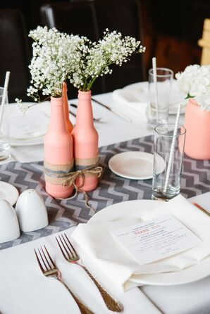 Coral Vase Centerpieces With Ivory Flowers