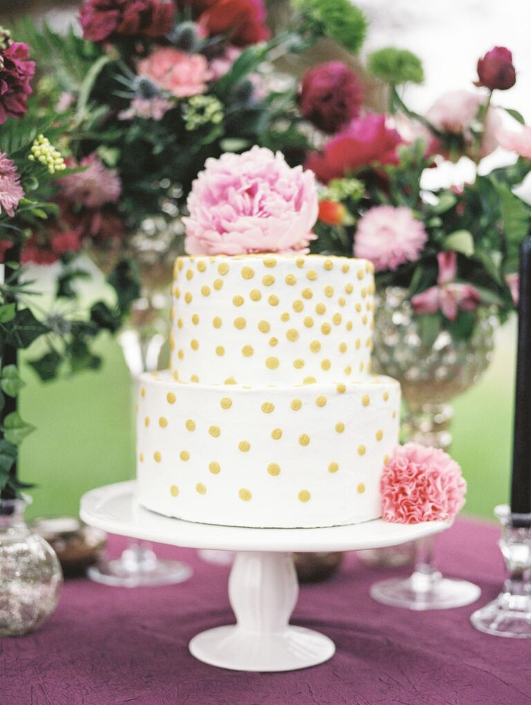 Tiered gold and white polka dot wedding cake
