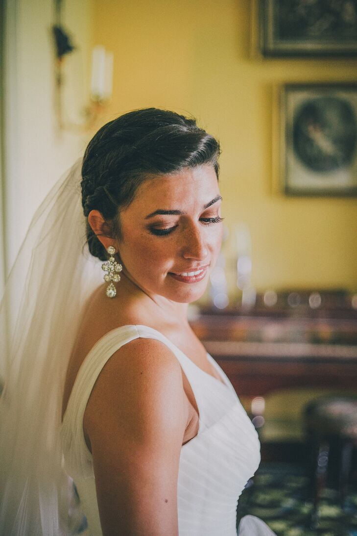 Cora just added stunning earrings to her ensemble, knowing that her wedding gown spoke for itself.