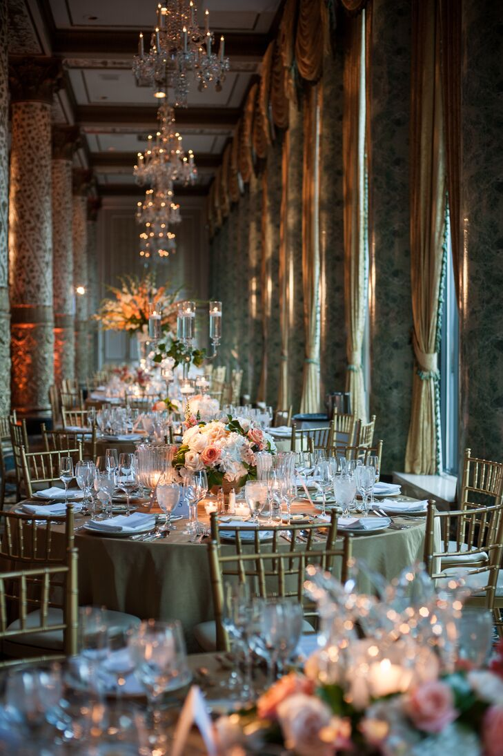 The reception took place in the Gold Coast Room at the Drake Hotel in Chicago, Illinois. The grand hall featured ornate marble pillars and crystal chandeliers. For the reception, round dining tables were covered in green linens and arranged with gold chiavari chairs.