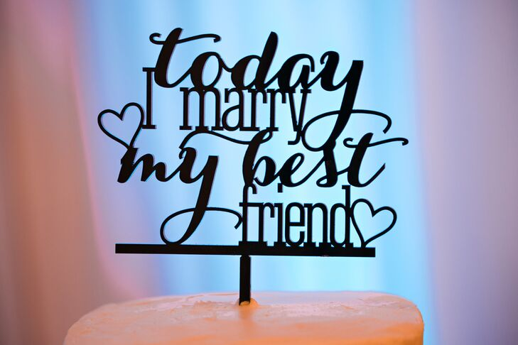 """Gloria and Jill's cake topper says it all: """"Today I marry my best friend"""" simply sums up the joy they felt on their wedding day."""
