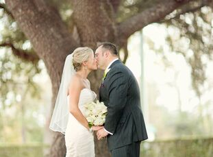 Adrian and Christopher exchanged vows at the historic Dunleith Plantation in Natchez, MS. The couple mixed jewel tones with yellow accents for a memor