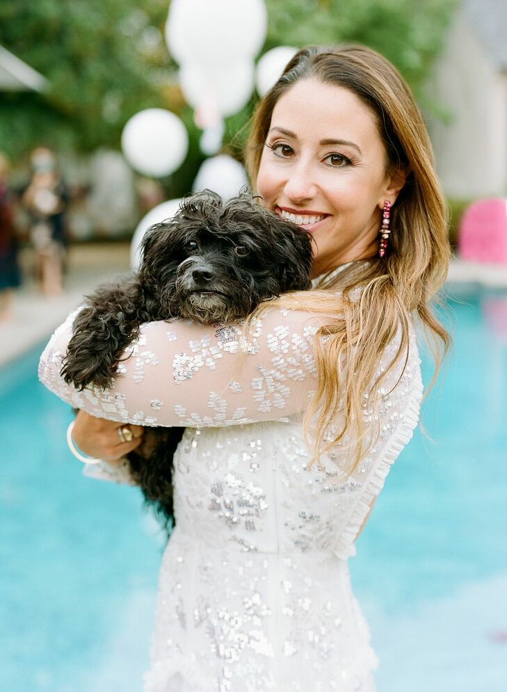 Bride Holding Dog During Microwedding in Potomac, Maryland