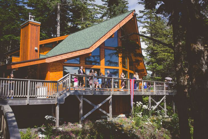 """""""The reception was held in a 100-year-old building on the old Sheldon Jackson college campus, now Sitka Fine Arts Camp,"""" Megan says. """"The building had recently been restored and had beautiful tall windows and a wooden interior that showed off the setting's natural beauty."""""""