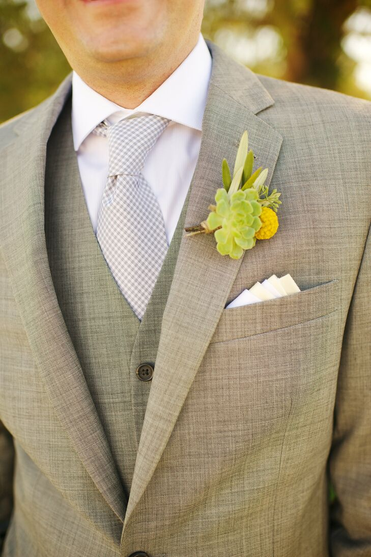 John wore a boutonniere with leafy greens and a single yellow billy ball. The boutonniere complemented Jenni's yellow bouquet beautifully.