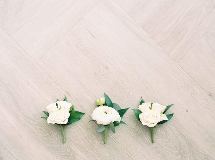 White Boutonnieres with Ranunculus and Roses
