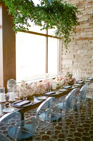 Romantic Farm Table with Ghost Chairs, Flower Centerpieces and Hanging Greenery