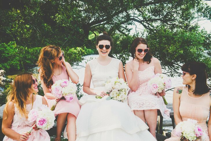 """Katie and her bridesmaids wore heart-shaped sunglasses as they happily sat next to each other, with their bouquets resting in their laps. """"The girls wore whatever pink dress they wanted,"""" Katie says. """"I wanted to be able to see the individuality that I love about all of them."""""""