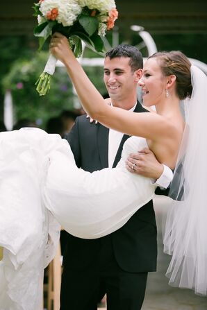 Groom Carries His Bride During the Recessional